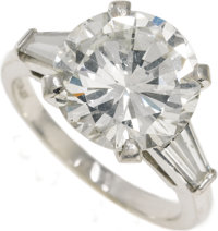 Diamond, Platinum Ring  The ring features a round brilliant-cut diamond measuring 11.25 - 11.20 x 6.48 mm and weighing a...