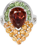 Estate Jewelry:Rings, Tourmaline, Orange Sapphire, Tsavorite Garnet, White Gold Ring. Thering is highlighted by a pear-shaped tourmaline measur...