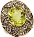 Estate Jewelry:Rings, Peridot, Diamond, Gold Ring. The ring centers an oval-shaped peridot measuring 16.50 x 14.00 x 9.30 mm and weighing approx...