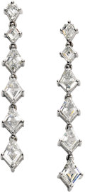 "Estate Jewelry:Earrings, Diamond, Platinum Earrings. Each ""Journey"" style earring features acalf's head-cut diamond supporting a graduated line of..."