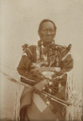 Photography:Official Photos, PROFESSOR STARR - WARRIOR OF THE TAOS. Elderly Indian warrior poseswith his bow and arrows, wearing several beaded necklace... (Total:1 Item)
