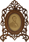 Political:Miscellaneous Political, Abraham Lincoln: Bearded Albumen Photo in a Lovely OpenworkVictorian Walnut Display Frame with Easel Back. ...