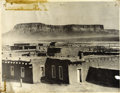 Photography:Studio Portraits, IMPRESSIVE OVERSIZED SCENIC VIEW OF ARIZONA PUEBLO. With majestic buttes soaring in the distance, this unidentified town swe... (Total: 1 Item)