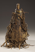 American Indian Art:Pipes, Tools, and Weapons, A PLAINS HIDE-COVERED POWDER FLASK. c. 1850...