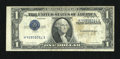 Error Notes:Inverted Third Printings, Fr. 1614 $1 1935E Silver Certificate. Fine.. ...
