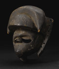 Other: , Ogoni (Nigeria). Mask, Elu. Wood, pigment. Height: 6 ¼ inches Width: 5 inches Depth: 4 ¼ inches. This mask has a sma...