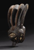 African: , Winiama (Burkina Faso). Mask with Four Horns. Wood, pigment.Height: 22 inches Width: 8 ½ inches Depth: 8 inches. Anothe...