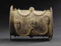 African: , Yoruba (Nigeria). Armlet. Copper alloy. Height: 5 ½ inches Dia.: 4½ inches. This hollow cylindrical armlet has flanges a...