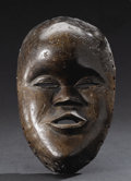African: , Dan (Liberia). Face Mask. Wood. Height: 8 7/8 inches Width: 5 ½ inches Depth: 2 ½ inches. This finely carved mask has a ...