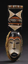 African: , Igbo (Nigeria), Afikpo region, carved by Chukwu Okoro probably inthe 1940s or 50s. Mask with short rectangular plaque, Mba...