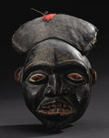 African: , Grasslands Kingdom (Cameroon). Helmet Mask. Wood, pigment, cloth, feathers, fiber. Height: 15 inches Width: 9 5/8 inches D...