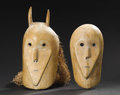 African: , Kissi (Guinea). Pair of Rice masks. Wood, pigment, fiber. Male: Height: 15 ½ inches Width: 6 ½ inches Depth: 5 ½ inches. F...