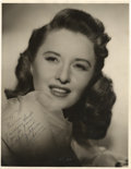 """Movie Posters, Barbara Stanwyck Publicity Still by Bert Six (Warner Brothers, 1945). Autographed Still (10.75"""" X 14"""")...."""