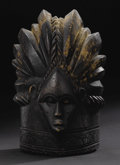 African: , Bassa (Liberia). Helmet Mask. Wood, nails. Height: 14 ½ inches Width: 7 7/8 inches Depth: 8 7/8 inches. Bassa helmet masks...