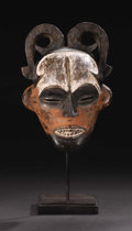 African: , Ibo (Nigeria). Female Mask. Wood, pigment. Height: 10 ¼ inches Width: 7 3/8 inches Depth: 3 ¾ inches. In southeastern Ni...