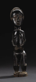 African: , Baule (Côte d'Ivoire). Female Figure. Wood, patination. Height: 14inches Width: 3 inches Depth: 3 5/8 inches. As Susan ...