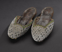 Asante (Ghana) Beaded slippers Leather, cloth, beads Length: 8 7/8 inches Width: 3 ¾ inches  A pair of women's sl...