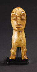 African: , Lega (Democratic Republic of Congo). Standing Figure. Bone. Height:5 7/8 inches Width: 2 inches Depth: 2 ¼ inches. Whet...