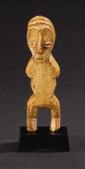 African: , Lega (Democratic Republic of Congo). Standing Figure. Bone. Height:6 ½ inches Width: 1 7/8 inches Depth: 2 inches. Of t...