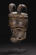 African: , Ibibio (Nigeria). Idiok Ekpo Mask with Hinged Jaw. Wood, fiber, nails. Height:13 ¾ inches Width: 6 7/8 inches Depth: ...