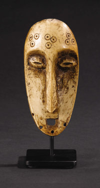 Lega (Democratic Republic of Congo) Mask Bone Height: 5 7/8 inches Width: 2 7/8 inches Depth: 1 3/8 inches  Among the