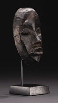 "African: , Dan (Liberia). ""Passport"" Mask. Wood. Height: 5 7/8 inches Width: 3 ½ inches Depth: 2 inches. Among the Dan and connecte..."