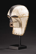 African: , Songe (Democratic Republic of Congo). Kifwebe Mask. Wood, pigment, twigs, hair. Height: 14 inches Width: 8 inches ...