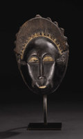 African: , Baule (Côte d'Ivoire). Mask. Wood, vine, pigment. Height: 10 ½inches Width: 7 3/8 inches Depth: 5 inches. This example ...