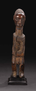 African: , Teke (Democratic Republic of Congo). Standing Male Figure. Wood.Height: 9 3/8 inches Width: 1 7/8 inches Depth: 2 inches...