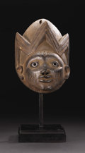 African: , Yoruba (Nigeria). Gelede Headdress. Wood, metal. Height: 12 ¾ inches Width: 7 7/8 inches Depth: 7 ¼ inches. The crow...