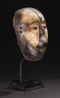 African: , Galwa (Gabon). Mask (Okukwe). Wood, pigment. Height: 12 inches Width: 7 ¾ inches Depth: 5 inches. This kind of mask,...