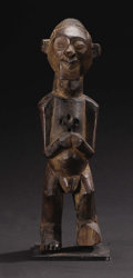African: , Teke (Democratic Republic of Congo). Standing Male Figure. Wood.Height: 13 ¼ inches Width: 4 inches Depth: 4 ¾ inches. ...