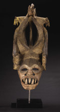African: , Igbo (Nigeria). Mgbedlike Mask. Wood, pigment. Height: 32 ½inches Width: 14 inches Depth: 16 inches. This magnifice...
