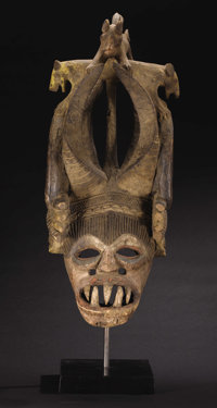 Igbo (Nigeria) Mgbedlike Mask Wood, pigment Height: 32 ½ inches Width: 14 inches Depth: 16 inches  This magnifice...