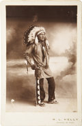 Military & Patriotic:Indian Wars, Cabinet Card Photograph of Armed Sioux Chief with Headdress, circa 1880s. ...