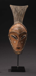 African: , Eastern Pende (Democratic Republic of Congo). Mask(Munyangi). Wood, pigment. Height: 14 ½ inches Width: 5 7/8inches ...