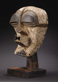 African: , Songe (Democratic Republic of Congo). Kifwebe Mask. Wood, pigment, hair. Height: 14 inches Width: 9 ¾ inches Depth: ...