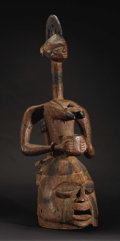 African: , Yoruba (Nigeria). Epa Helmet Mask: Mother and Child Group. Wood, pigment, indigo. Height: 33 7/8 inches Width: 13 ¼ inc...
