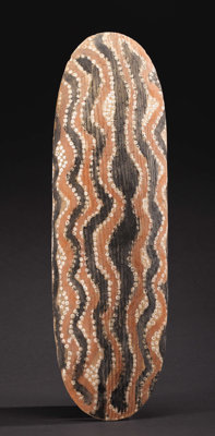 Central Desert (Australia) Shield Wood, pigment Height: 27 inches Width: 8 3/8 inches  Although the back of this shiel...