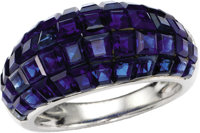 Sapphire, Platinum Ring, Van Cleef & Arpels  The dome-style ring features invisibly-set square-cut sapphires weighin...