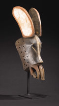African: , Guro (Côte d'Ivoire). Hippoptamus Mask (Bolu). Wood, pigment. Height: 7 inches Length: 23 inches Width: 7 inches. Th...