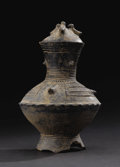 African: , Akan (Ghana). Pot with lid. Ceramic. Height: 9 1/4 inches Width: 6½ inches. This is a footed vessel with a distinct and...
