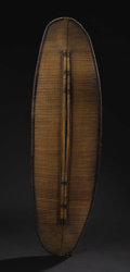 African: , Mongo Region (Democratic Republic of Congo). Shield. Basketry, wood. Height: 51 ¾ inches Width: 15 ½ inches Depth: 1 inch...