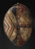 African: , Kenya. Maasai. Two Shields. Hide, pigment, wood. (1) Height: 36inches Width: 23 ¼ inches Depth: 4 ½ inches. (2)Height: 34...