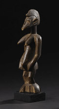 African: , Senufo (Côte d'Ivoire). Female figure. Wood. Height: 10 ½ inchesWidth: 3 1/8 inches Depth: 3 1/8 inches. This simplif...