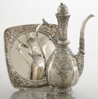 AN AMERICAN SILVER COFFEE POT AND UNDER TRAY Gorham Manufacturing Co., Providence, Rhode Island, 1886 Marks: (l