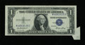 Error Notes:Attached Tabs, Fr. 1614 $1 1935E Silver Certificate. Extremely Fine.. ...