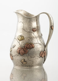 AN AMERICAN SILVER AND MIXED METAL CREAM PITCHER Tiffany & Co., New York, New York, circa 1878 Marks: TIFFAN