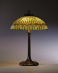 """Decorative Arts, American:Lamps & Lighting, TIFFANY STUDIOS. A """"Vine Border"""" Leaded Glass and Bronze Table Lamp, circa 1910. Shade stamped: TIFFANY STUDIOS N.Y. 1498... (Total: 2 Items)"""