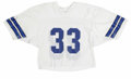 Football Collectibles:Uniforms, 1980s Tony Dorsett Dallas Cowboys Practice-Worn Jersey. White mesh jersey with the number 33 on front and verso. This was a...